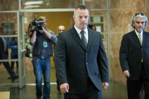 Fired San Francisco Sheriff's Deputy Scott Neu, center, after his court appearance at the Hall of Justice